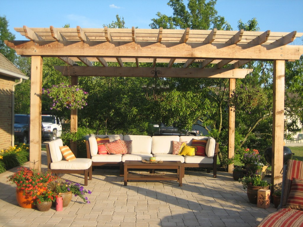 Contemporary wooden pergola placed in the front yard