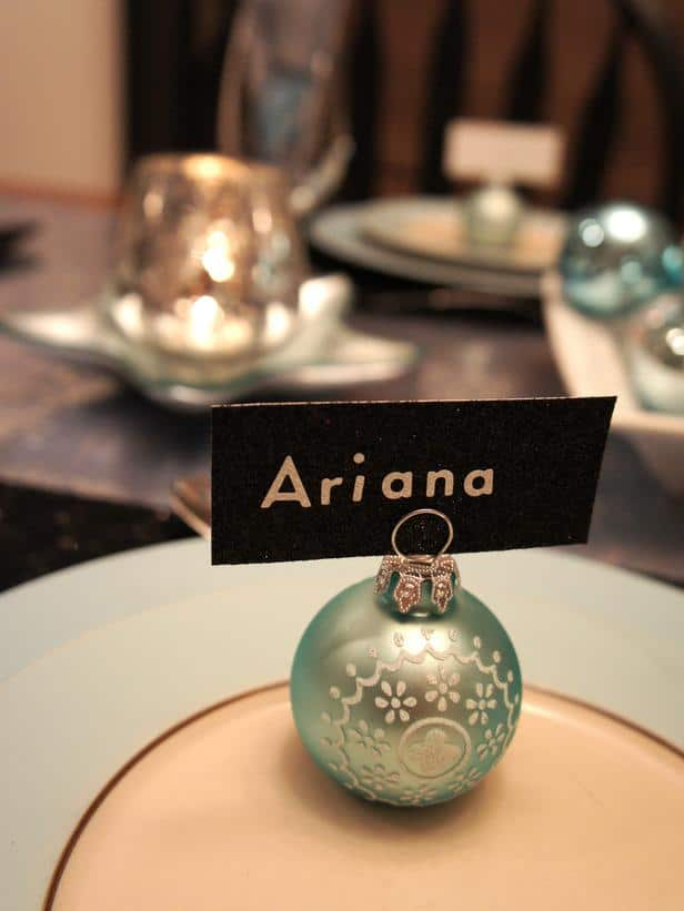 Blue ornament ball used as a card holder - 24 Dazzling Settings for a Sparkling Holiday Night