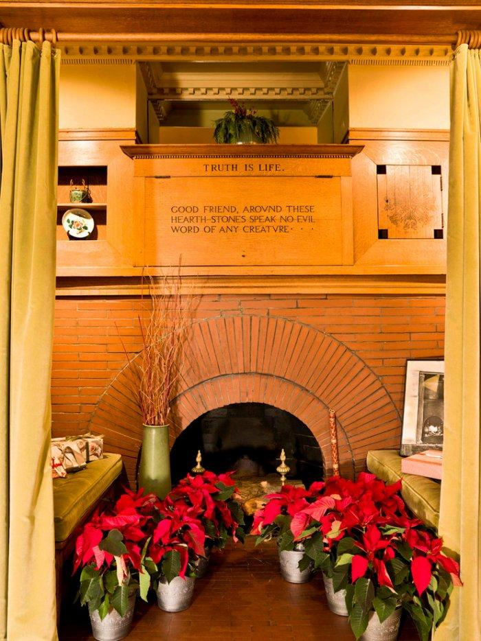 Fresh flowers arranged in front of the fireplace - Christmas Home Decor Ideas and Examples