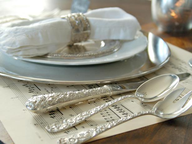 Silver forks, knives and spoons create a Classic Christmas table look - Add an elegant Touch to Your Holiday Decorations
