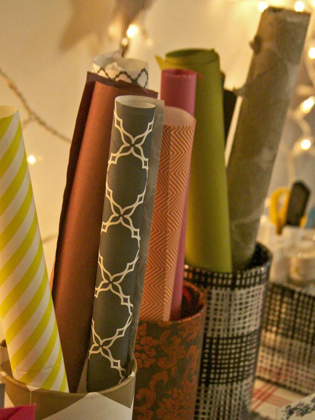 Vases filled with patterned gift wrapping paper - Christmas Table Decoration Ideas