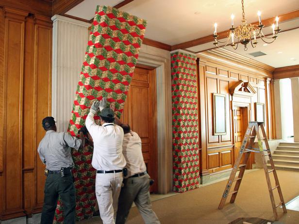 Workers try to fit a decorative wall column - Holiday Ideas from America's First Home