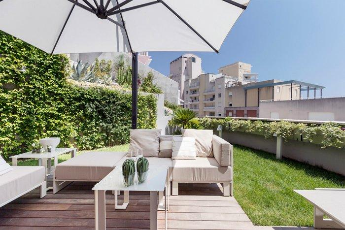 Comfortable patio furniture in white placed at the outdoor terrace - Stylish and Elegant Apartment in Monaco