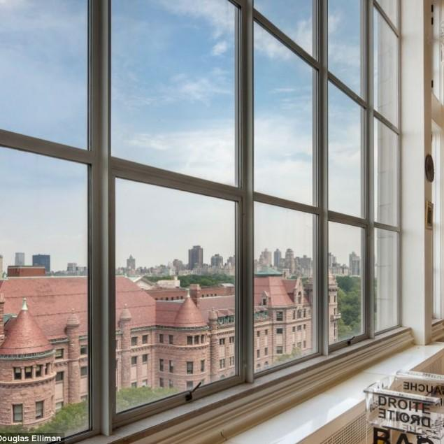 Glass windows overviewing the American Museum of Natural History - $20 Million Luxury and Artful Interior of a New York Loft