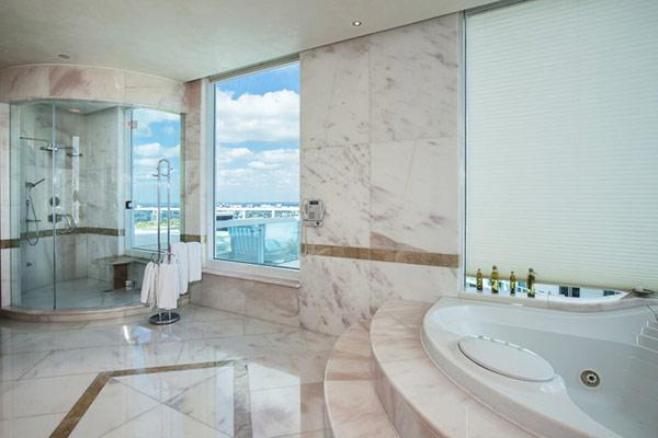 Luxury bathroom in white marble - Pharrell Williams' Miami Penthouse Interior at a Glance