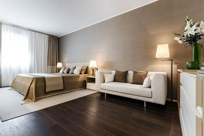 Master bedroom interior design in earth wood tones - Stylish and Elegant Apartment in Monaco