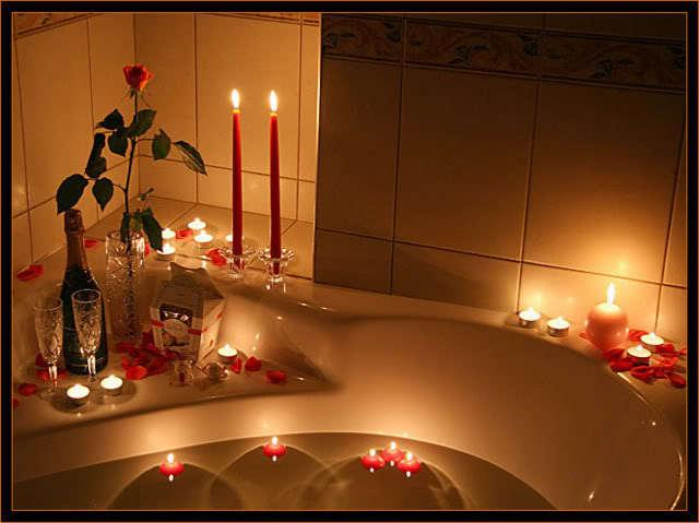 Red candles for a Valentine's night in the bathroom - 10 Decorating Ideas For a Sexy Night