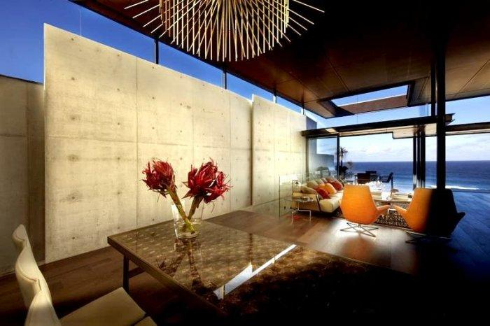 Red flowers used as table decoration - Modern Dream House Overlooking the Pacific Ocean in Sydney