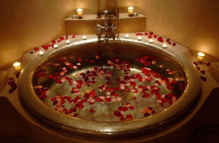 Romantic red rose petals in a bathtub - 10 Decorating Ideas For a Sexy Night