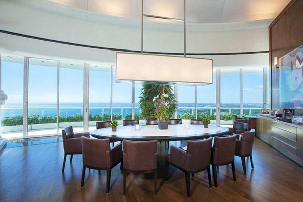 Spacious dining room with splendid view over the ocean - Pharrell Williams' Miami Penthouse Interior at a Glance