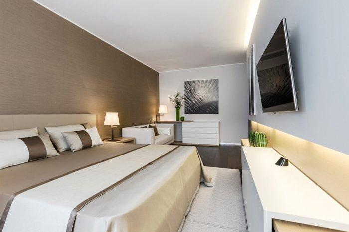 Spacious and luxurious master bedroom design in warm brown hues - Stylish and Elegant Apartment in Monaco