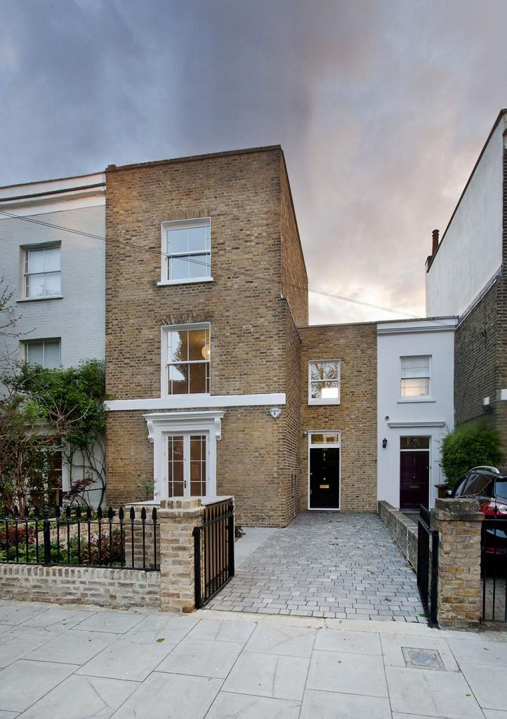 Street view of a Victorian house - A modern look at an Old Home in London