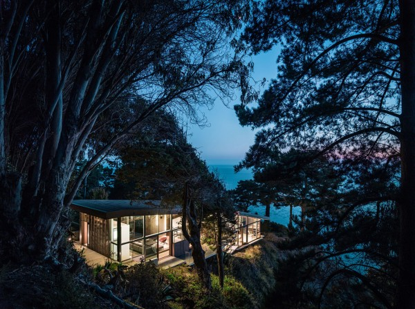 A view towards the lake and house at night-Spectacular Contemporary Glazed Lakeside Home in California