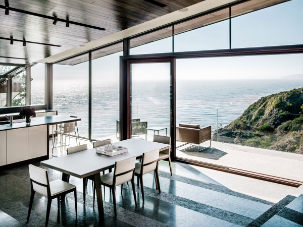 Breathtaking views over the lake from the dining area-Spectacular Contemporary Glazed Lakeside Home in California