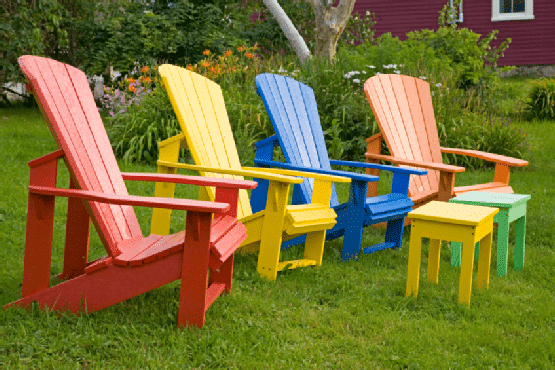 Colorful Adirondack chairs on the front lawn-Sweet and Interesting Patio and Garden Furniture Ideas