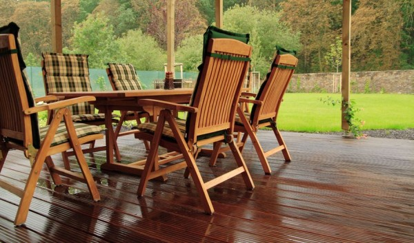 Comfortable folding chairs placed on a wooden deck-Sweet and Interesting Patio and Garden Furniture Ideas