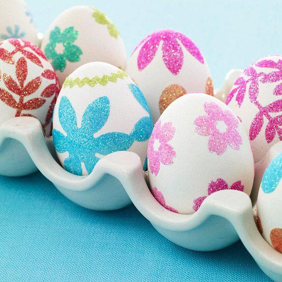 Easter eggs decorated with colorful flowers– Easter Basket and Eggs Ideas for Decorations in Many Colors