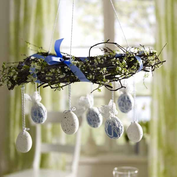 Easter wreath and colorful eggs hanging from it - 44 Home Decoration Ideas for table, living room and door