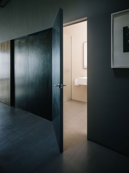 Entering the small minimalist bathroom-The interior design of a contemporary property in San Francisco