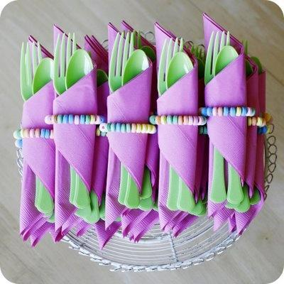 Green flatware wrapped in purple napkins-Unique, Fresh and Exciting Easter Table Decoration Ideas