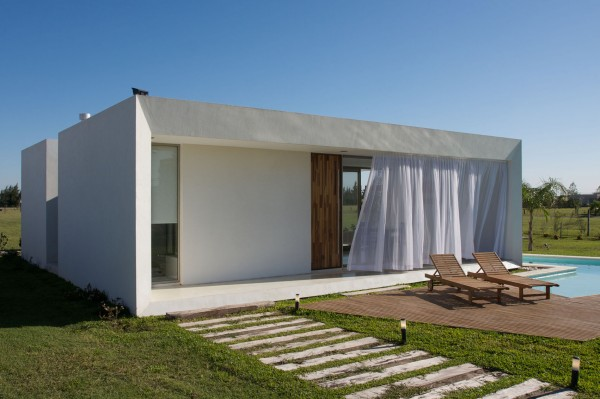 Marvelous Relaxing Zone With Wooden Lounge Chairs Extermely Tiny Modern Home By  VismaraCorsi Arquitectos