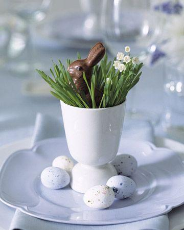 Small chocolate rabbit hiding in a porcelain arranged cup holder-Unique, Fresh and Exciting Easter Table Decoration Ideas