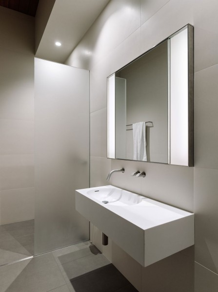 Small minimalist loft bathroom in white-The interior design of a contemporary property in San Francisco