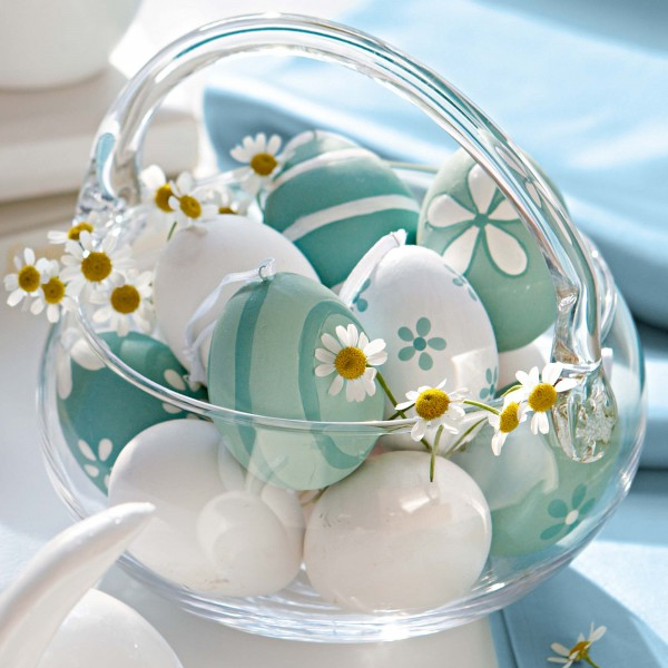 White and blue Easter eggs under in a glass basket - 44 Home Decoration Ideas for table, living room and door