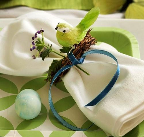 White linen napkin, fresh flower ribbon, funny decorative bird and green egg-Unique, Fresh and Exciting Easter Table Decoration Ideas