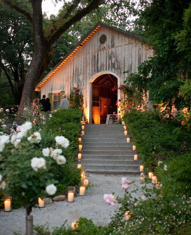 beautiful pebble path with candles leading to a