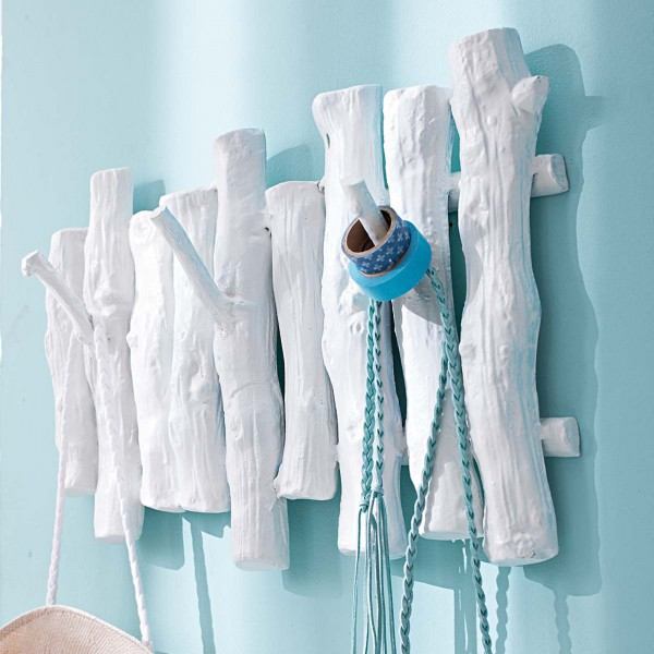 creative-hat-and-coat-rack-made-of-wood-and-painted-in-white- 21 Creative and Functional Home Furniture Examples