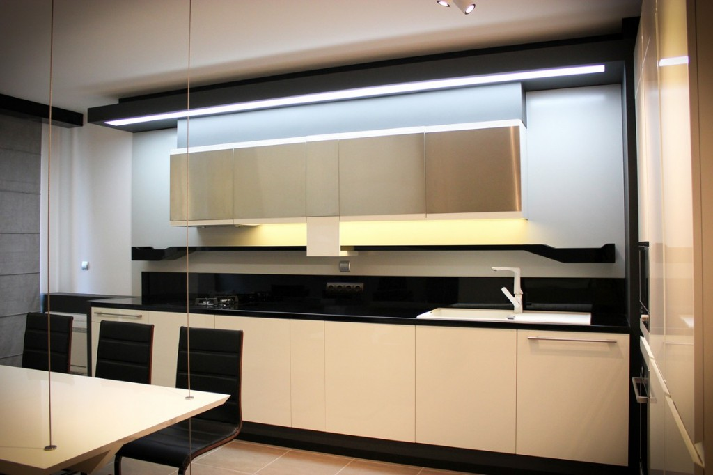 elegant small kitchen of contrast colors-Interior Design of Apartment in Bulgaria