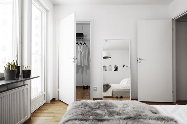 functional small bedroom in white- Minimalist Small Apartment Interior Design