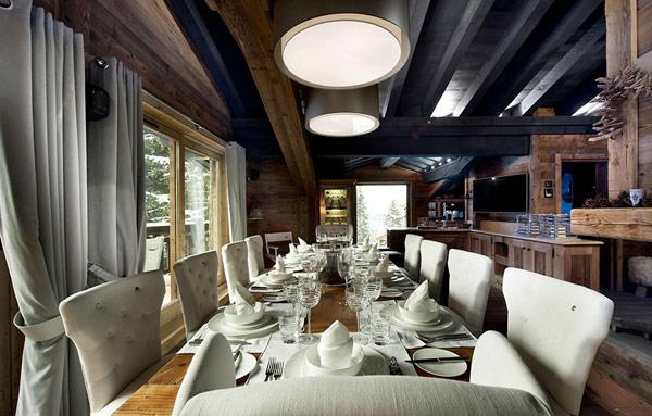 long-dinner-table-in-a-contemporary-rustic-mountain-villa- Le Petit Chateau in the French Alps