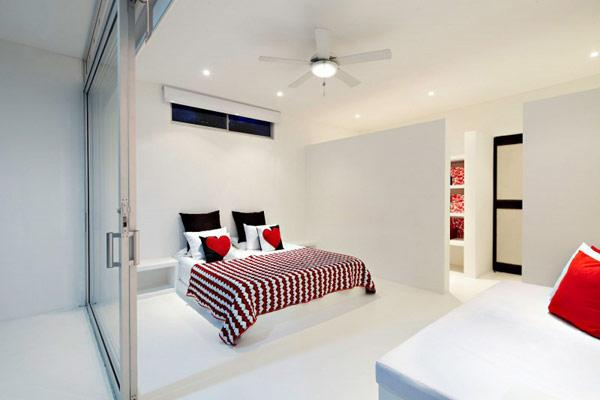 lovely-small-white-minimalist-bedroom-with-red-accents