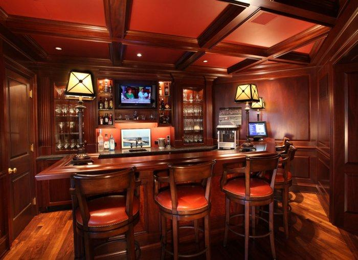 luxurious-home-bar-with-dark-wooden-colors-and-leather-bar-stools