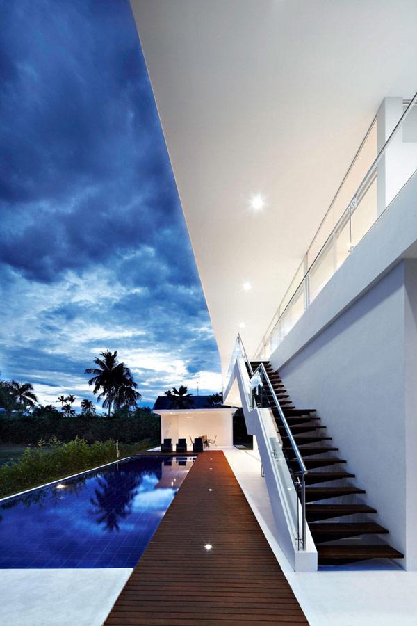 luxurious-minimalist-white-house-at-dusk