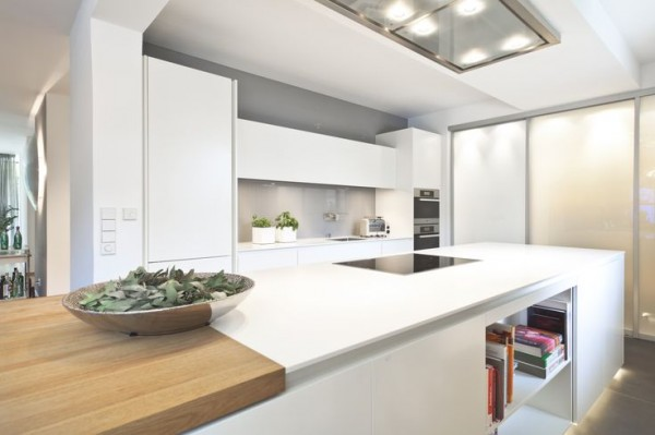 minimalist-kitchen-in-white-colors-combined-with-wooden-elements- Interior Design and Furniture trends for cooking areas