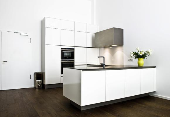 minimalist-loft-kitchen-with-clean-and-simple-lines-in-white- Interior Design and Furniture trends for cooking areas