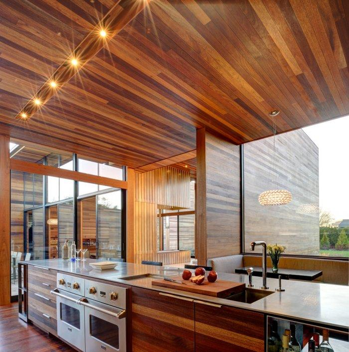Modern kitchen with mahogany and huge windows providing beautiful views - Mahogany Inspired Expensive House in New York