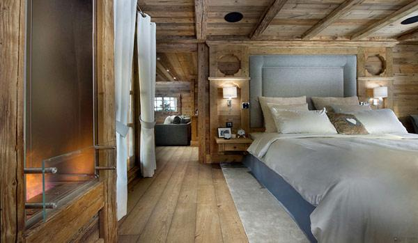 natural-toned-bedroom-with-beautiful-views- Le Petit Chateau in the French Alps