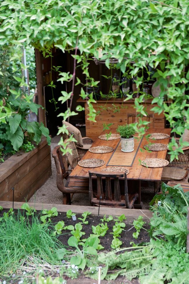 rustic-dinning-table-with-vintage-flatware-and-an-outdoor-kitchen-besides- Contemporary Outdoor Garden Ideas