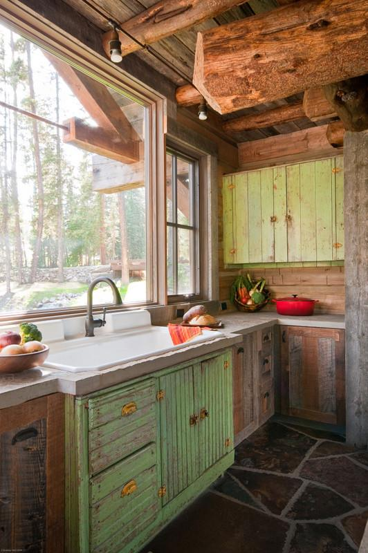 Rustic kitchen with barn beams and beautiful views from the sink - 16 Advices and Examples for Creating a Cozy Atmosphere in the Cooking Areas
