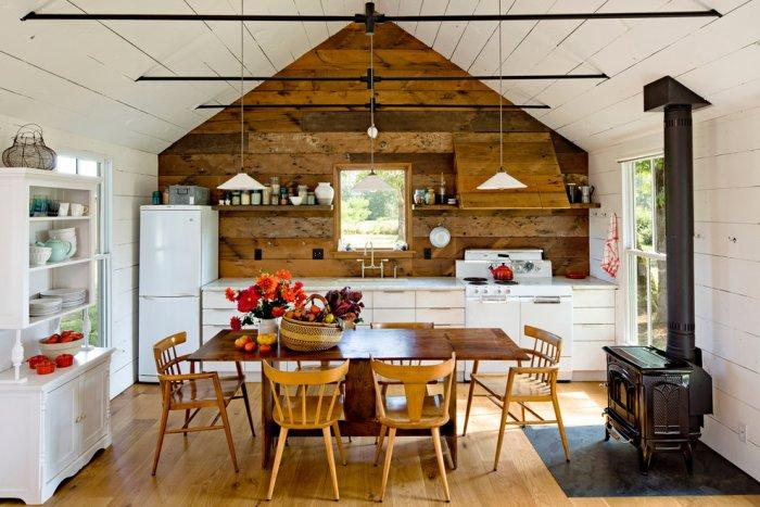 Rustic kitchen with white walls and woodstove - 16 Advices and Examples for Creating a Cozy Atmosphere in the Cooking Areas