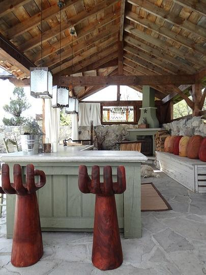 Rustic Outdoor Kitchen With Creative Bar Stools 20 Ideas And Examples