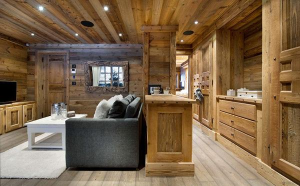 small-and-comfortable-rustic-tv-room- Le Petit Chateau in the French Alps