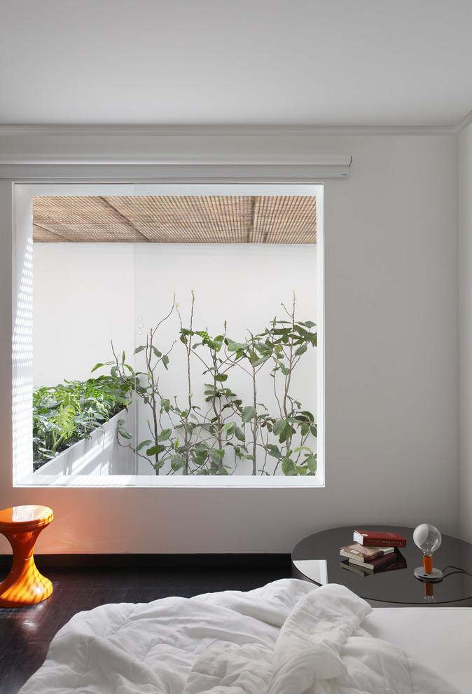 Bedroom with creative minimalist interior and window looking to the inner courtyard- Small House in simple and elegant style in Sao Paolo