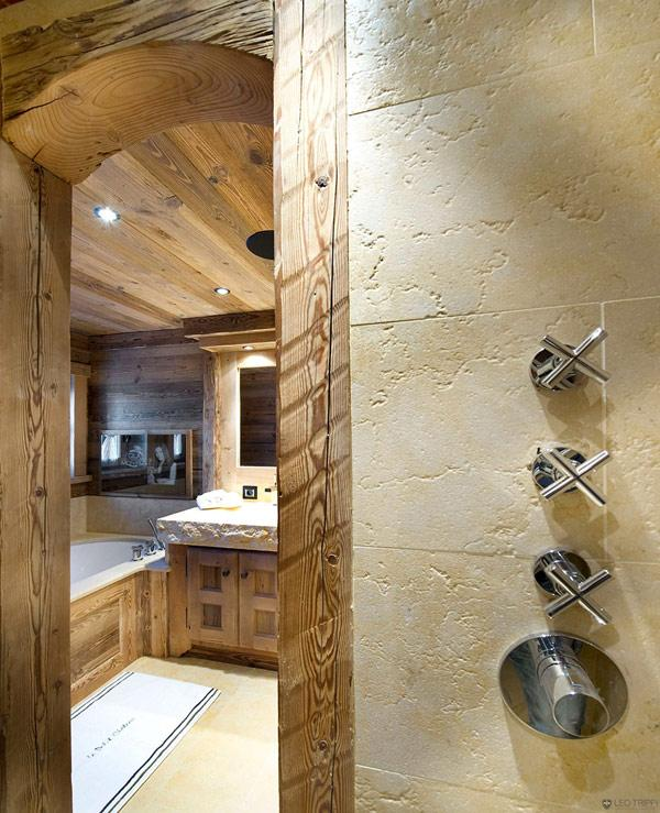 spacious-bedroom-with-wooden-interior- Le Petit Chateau in the French Alps