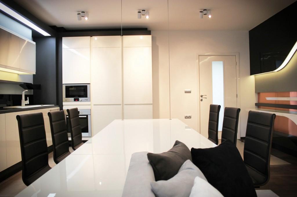stylish futuristic dinning table design in black and white-Interior Design of Apartment in Bulgaria