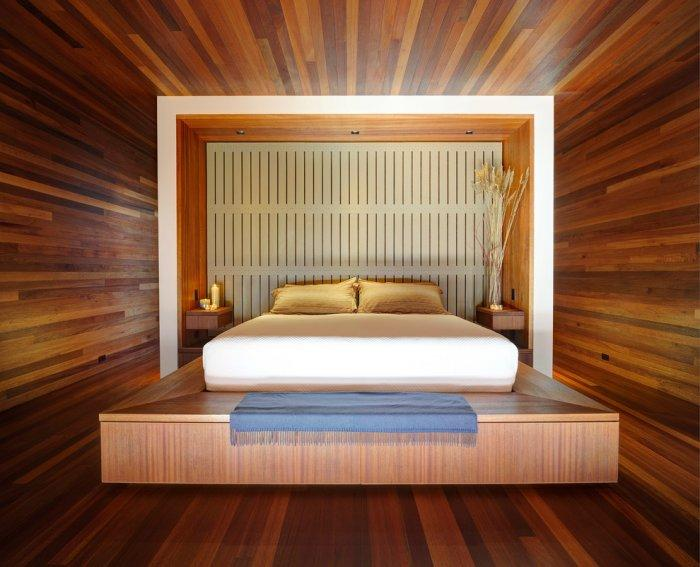 Stylish minimalist master bedroom interior design with designer platform bed- Mahogany Inspired Expensive House in New York